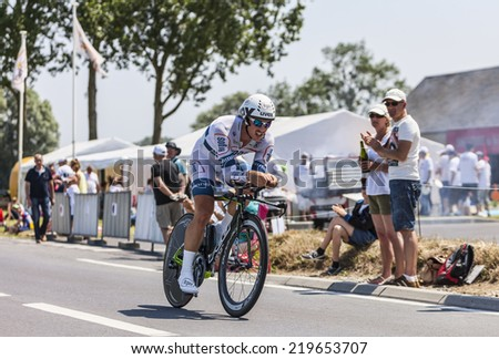 ARDEVON,FRANCE-JUL 10:The German cyclist John Degenkolb from Argos-Shimano Team cycling during the stage 11 (time trial Avranches -Mont Saint Michel) of Le Tour de France on July 10, 2013 - stock photo