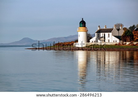 Ardgour Lighthouse reflecting on Loch Linnhe near Fort William, Scotland. - stock photo