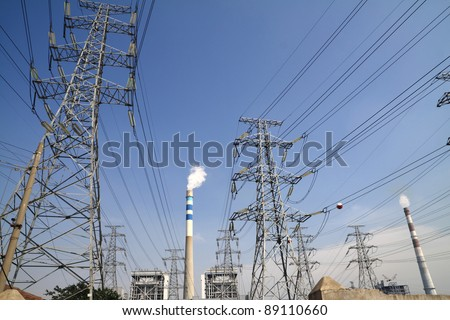 Are power plants and transmission tower chimney smoke - stock photo
