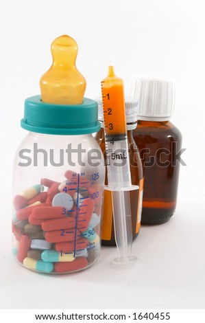 Are we feeding the children too much drugs? Pills in a bottle to represent feeding children medication. - stock photo