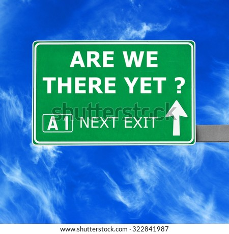 ARE WE THERE YET road sign against clear blue sky - stock photo