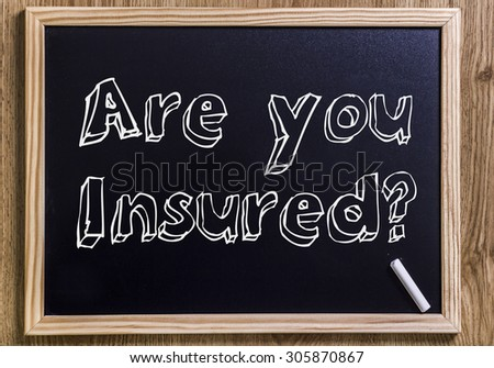 Are you Insured? - New chalkboard with outlined text - on wood - stock photo