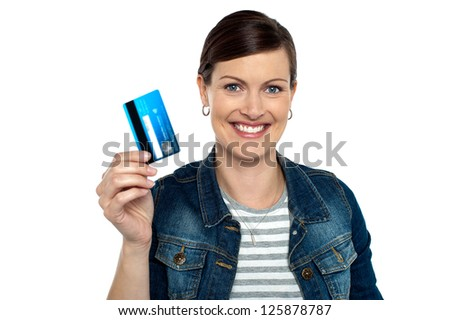 Are you ready to shop? Shopaholic woman showing cash card. - stock photo