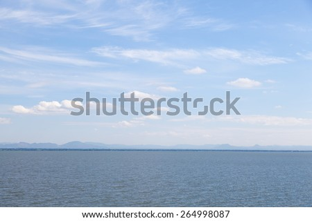 Area lake and sky. Cloud in sky on a clear day vacation. - stock photo