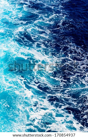 Areal shot of deep blue and rough sea with lot of sea spray - stock photo