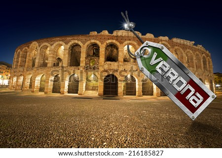Arena di Verona with Metal Tag / Arena of Verona at night, (UNESCO world heritage site), I-III century - Roman amphitheater with metal tag, steel cable, bolts and text Verona - Italy - stock photo