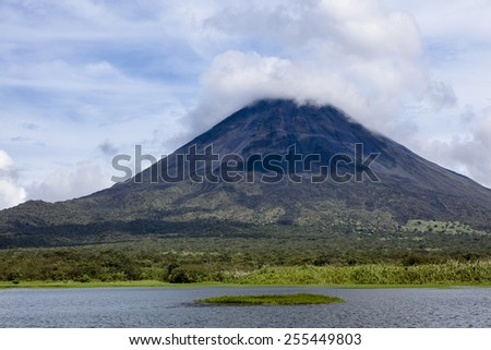 Arenal Volcano is an active andesitic stratovolcano in north-western Costa Rica - stock photo