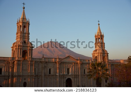 Arequipa Cathedral at dusk with the Volcano Misti (5822m) in the background. Arequipa, Peru. - stock photo