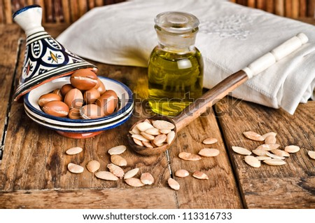 Argan fruit, seeds and oil, used in cosmetics and alimentary products - stock photo