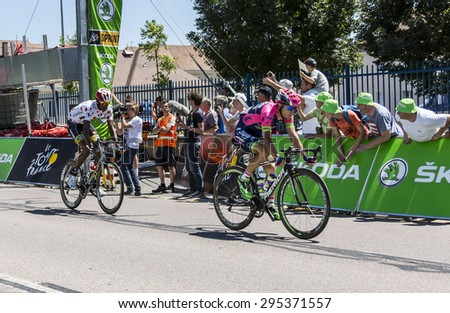 ARGENTAN, FRANCE - JUL 10:Kristijan Durasek of Lampre Merida and Daniel Teklehaimanot of MTN-Qhubeka crossing the line of the intermediate sprint in Argentan during Tour de France on 10 July 2015. - stock photo