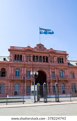 Argentine Government House, also called Casa Rosada by color, with the Argentina flag flying. Buenos Aires. - stock photo