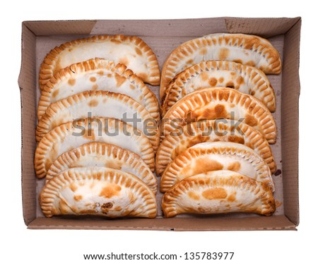 Argentinian empanada, meat pie on white background. Dozen. - stock photo