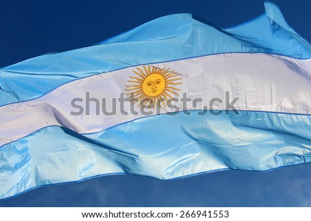 Argentinian flag waving against the blue sky, Argentina - stock photo