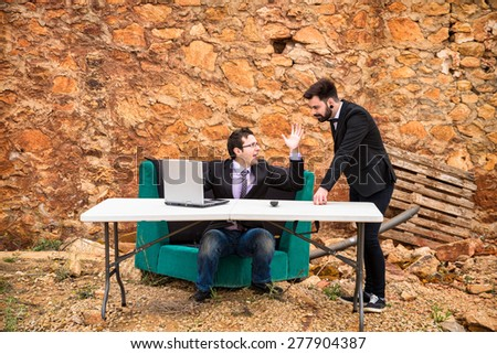 Argument ensuing in a grunge office, a business concept - stock photo