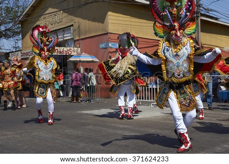 ARICA, CHILE - JANUARY 22, 2016: Masked members of a Diablada dance group performing as part of the Carnaval Andino con la Fuerza del Sol in Arica, Chile. The dance originates in Oruro, Bolivia - stock photo