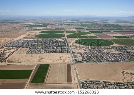Arizona desert and farmland seeing growth from encroaching subdivisions - stock photo