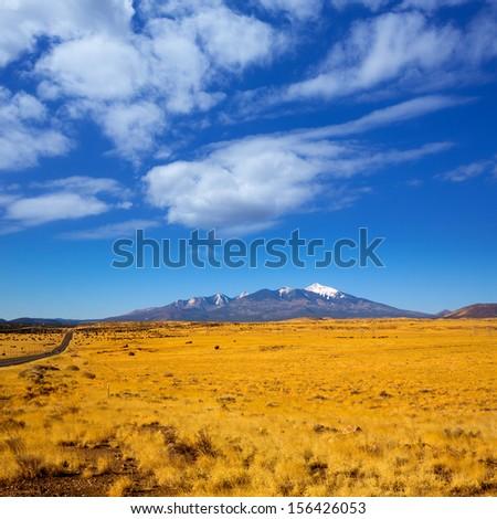 Arizona Highway 89 US with view of snowed mountains in Humphreys peak near Flagstaff - stock photo