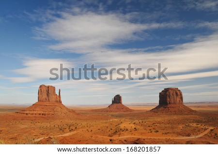 ARIZONA - OCTOBER 23: View of West Mitten Butte, East Mitten Butte, and Merrick Butte in Monument Valley. - stock photo