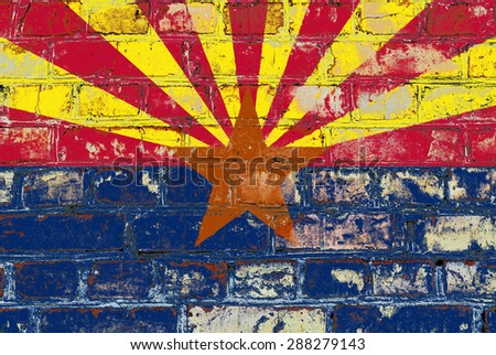 Arizona state flag of America on brick wall - stock photo