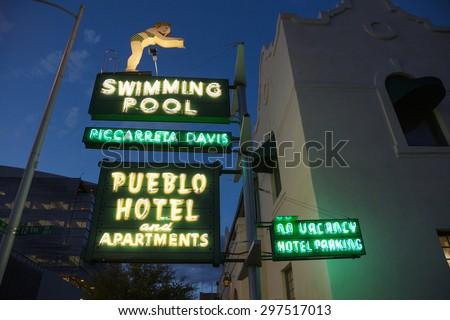 "Arizona, Tucson, USA, April 7, 2015, vintage neon for ""Swimming Pool and Pueblo Hotel"", - stock photo"