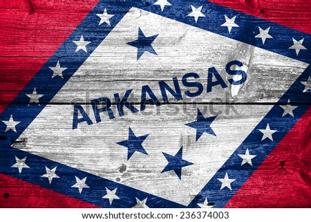Arkansas State Flag painted on old wood plank texture - stock photo