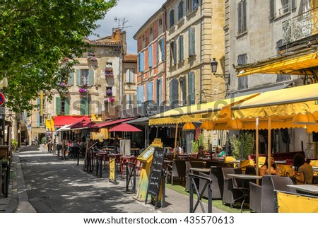Arles, France on the 10th June 2016: The Place du Forum, is where the Dutch artist Vincent Van Gogh painted the Cafe Terrace at Night painting and is now a major tourist location in Arles France - stock photo