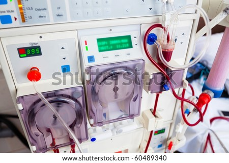 arlificial kidney (dialysis) device with rotating pumps. closeup view. - stock photo