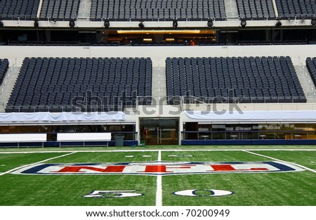 ARLINGTON - JAN 26: A view of the 50 yard line and player field entrance in Cowboys Stadium in Arlington, Texas sight of Steelers Packers Super Bowl XLV. Taken January 26, 2011 in Arlington, TX. - stock photo