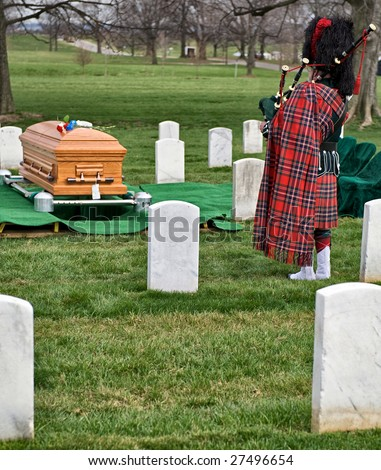 Arlington National Cemetery funeral with bagpiper playing for burial - stock photo