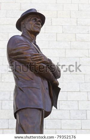 ARLINGTON, TEXAS - JUNE 13: Statue of Dallas Cowboy head coach, Tom Landry outside Dallas Cowboy Field, home of the NFL Cowboys, on June 13, 2011 in Arlington, Texas. - stock photo