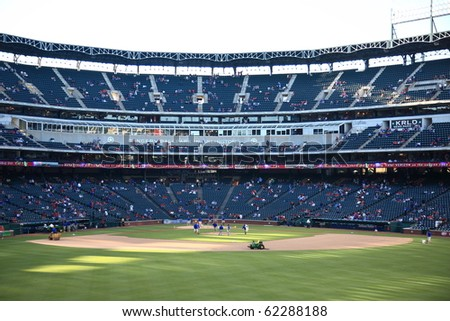 ARLINGTON, TEXAS - SEPTEMBER 27: Pregame activities at The Ballpark in Arlington before a game between the Rangers and Seattle Mariners on September 27, 2010 in Arlington, Texas. - stock photo