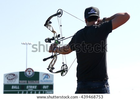 ARLINGTON, TX - APR 18: Recording artist Luke Bryan paticipates at the ACM & Cabela's Great Outdoor Archery Event at the Texas Rangers Youth Ballpark on April 18, 2015. - stock photo