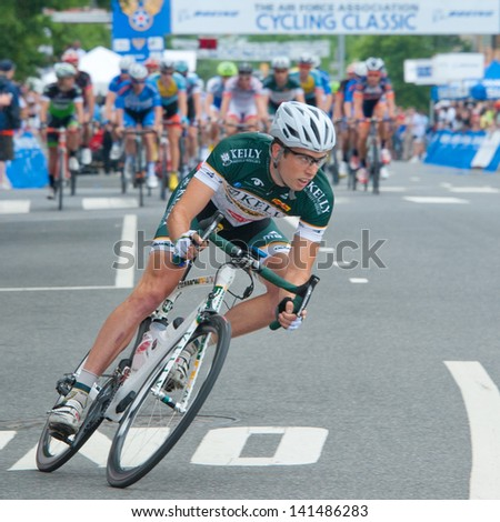 ARLINGTON, VIRGINIA - JUNE 8: A cyclist takes the early lead in the Men's Pro Invitational of the U.S. Air Force Cycling Classic on June 8, 2013 in Arlington, Virginia - stock photo