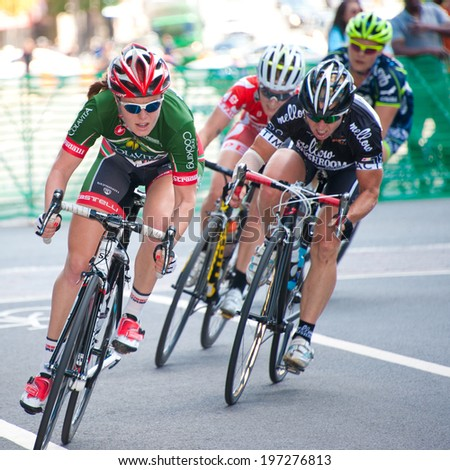 ARLINGTON, VIRGINIA - JUNE 7: Cyclists compete in the Clarendon Cup elite women's race at the Air Force Cycling Classic on June 7, 2014 in Arlington, Virginia - stock photo