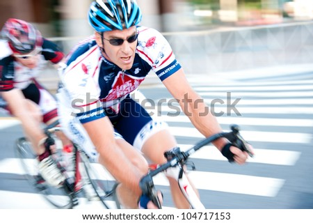 ARLINGTON, VIRGINIA - JUNE 9: Cyclists compete in the Masters 40+ race at the U.S. Air Force Cycling Classic on June  9, 2012 in Arlington, Virginia - stock photo
