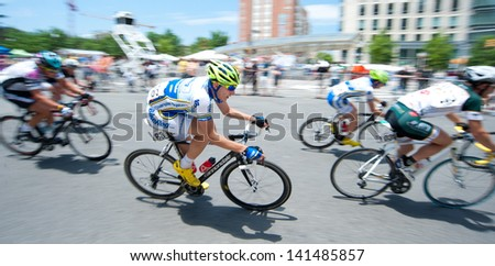 ARLINGTON, VIRGINIA - JUNE 8: Cyclists compete in the Men's Pro Invitational at the U.S. Air Force Cycling Classic on June 8, 2013 in Arlington, Virginia - stock photo