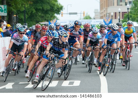 ARLINGTON, VIRGINIA - JUNE 8: Cyclists compete in the Men's Pro Invitational of the U.S. Air Force Cycling Classic on June 8, 2013 in Arlington, Virginia - stock photo