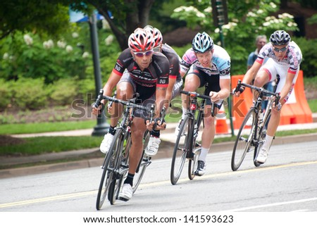 ARLINGTON, VIRGINIA - JUNE 9: Cyclists compete in the Men's Pro/1 race at the Air Force Cycling Classic on June 9, 2013 in Arlington, Virginia - stock photo