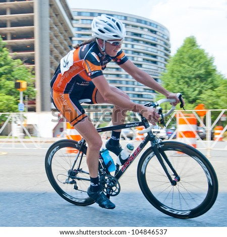 ARLINGTON, VIRGINIA - JUNE 10: Unidentified elite woman cyclist competes in the U.S. Air Force Cycling Classic on June 10, 2012 in Arlington, Virginia - stock photo