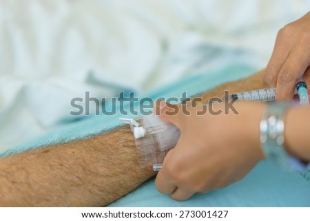 Arm of a man patient in the hospital. - stock photo