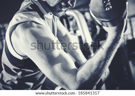 Arm of strong man doing exercise with barbell - stock photo