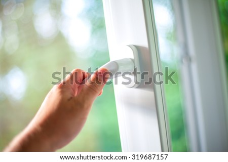 Arm open white plastic window. - stock photo