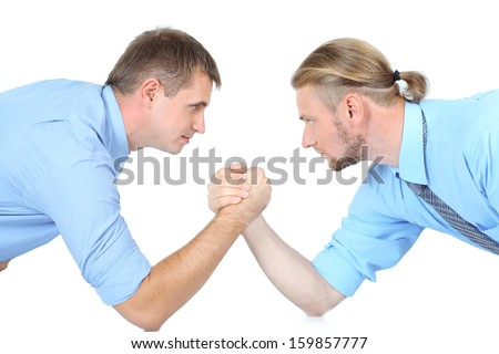 Arm wrestling of business people isolated on white - stock photo