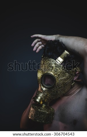 armageddon, depression and danger man with golden gas mask - stock photo
