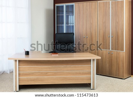 Armchair of manager on a background of a window - stock photo
