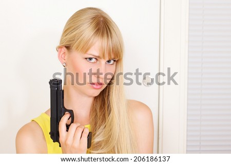 Armed girl at door about to break and enter - stock photo