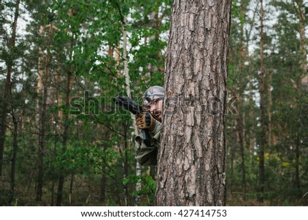 Armed man in a zone of armed conflict - stock photo