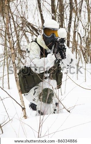 armed men in a camouflage play a paintball - stock photo