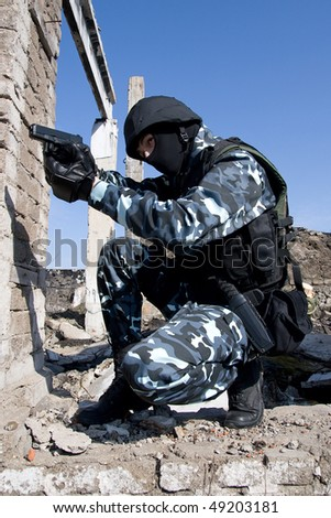 Armed officer aiming the target with 9mm semi-automatic pistol - stock photo