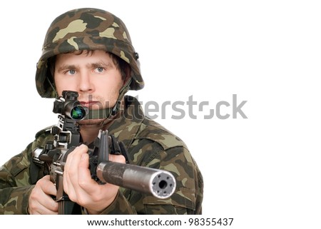 Armed soldier pointing m16 in studio. Isolated - stock photo